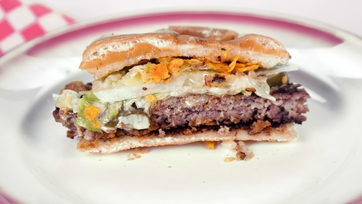 Chip-Encrusted Sausage Burger with Blue Cheese Fondue
