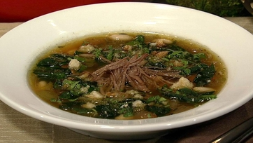 Michael Symon\'s Hearty Pork Soup with White Beans and Spinach