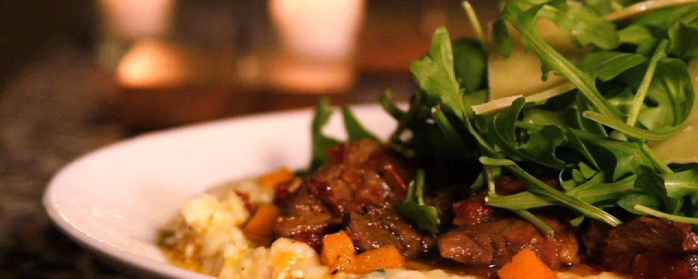 Carla Hall\'s Duck Ragu over Butternut Squash Grits