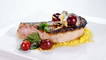 Traci Des Jardins\' Grilled Pork Chops with Cherry Almond Salsa and Creamed Corn