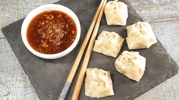 Chicken and Shrimp Dumplings with Spicy Ginger Dipping Sauce Recipe by Clinton Kelly