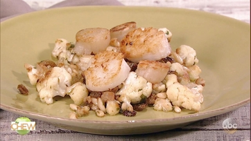 Michael Symon\'s Pan Roasted Scallops with Cauliflower, Raisins, and Pine Nuts