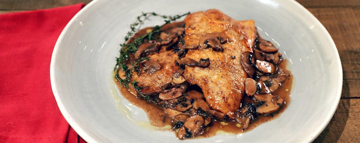 Once chicken breasts are finished cooking, don't wash the pan. The browned bits on the bottom of your skillet are flavor gold. For this dish, a simple pan sauce of pre-sliced mushrooms, dry white wine, shallots, and fresh thyme enlivens basic sautéed chicken breasts.
